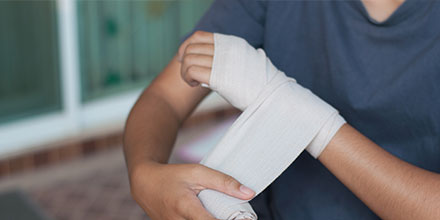 photograph of a man getting his hand splinted as part of certified hand therapy treatment