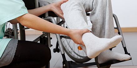photograph of client learning to use a wheelchair as part of their spinal cord rehabilitation therapy plan